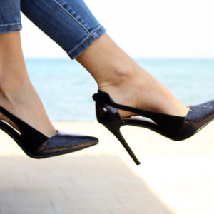 Patient wearing heels two months after bunion surgery