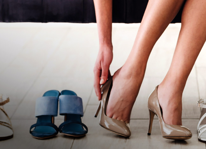 Woman putting on a pair of heels