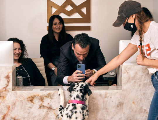 Dr. Blitz and staff taking a picture of his pet Dalmatian