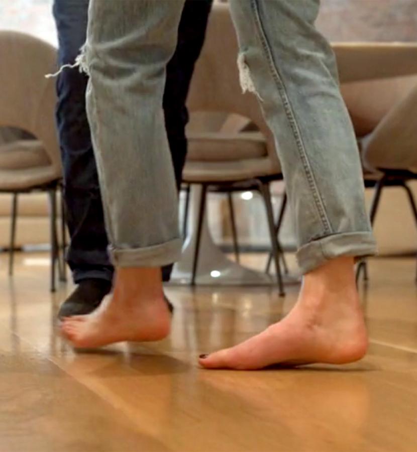 Woman dancing barefoot on floor