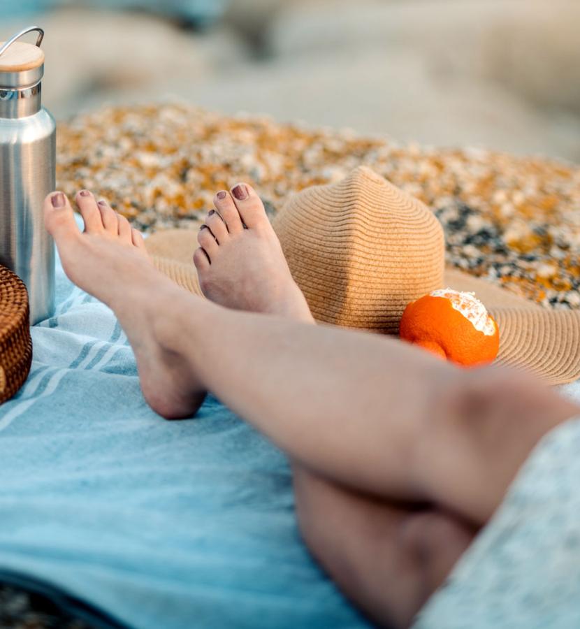 Barefoot woman relaxing on beach